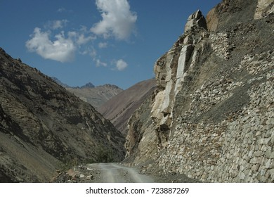 Steep, narrow mountain road with dangerous dropoff on descent from Rizong gompa MonasteryLadakh, India
