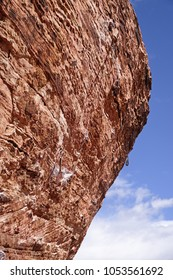 steep overhanging rock climb at Red Rock Conservation Area with quick draws hanging on bolts