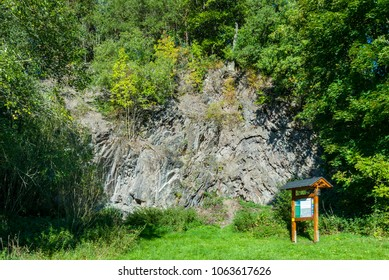 Steep rock face in the Vitsenböhl quarry in the district Düdinghausen of Medebach, Hochsauerland, Germany