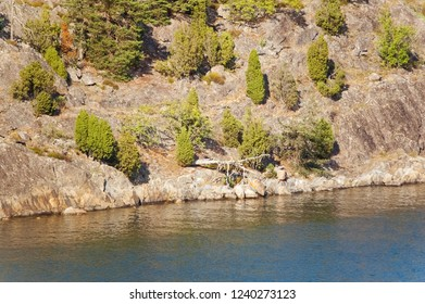 Steep Rocky Cliff Shoreline with Trees