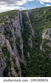 Steep rocky cliffs of Lazar's Canyon (Lazarev kanjon), the deepest and longest canyon in eastern Serbia, near the city of Bor - Shutterstock ID 1991909876