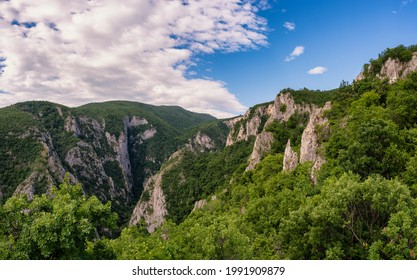 Steep rocky cliffs of Lazar's Canyon (Lazarev kanjon), the deepest and longest canyon in eastern Serbia, near the city of Bor - Shutterstock ID 1991909879