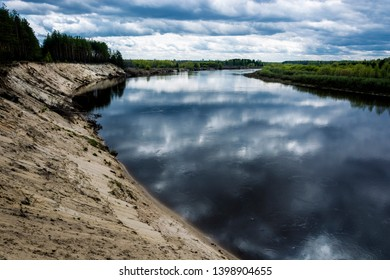Steep sandy cliff on the Klyazma River in the Ivanovo Region, Russia.