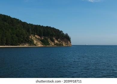 Steep sea coast and blue sea