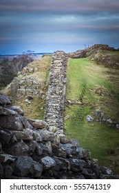 steep section of Hadrian's Wall at Walltown Crags looking towards Milecastle 45 .