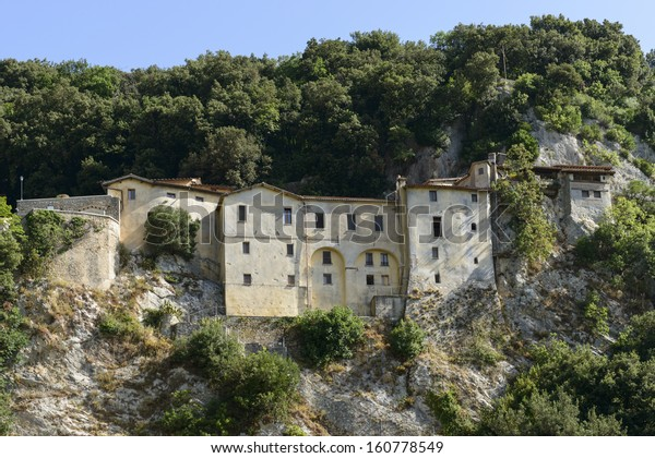 """steep side of Greccio Franciscan monastery, Rieti view of the steep side of Greccio Franciscan monastery in the """"holy valley"""", so called since san Francesco lived there,"""