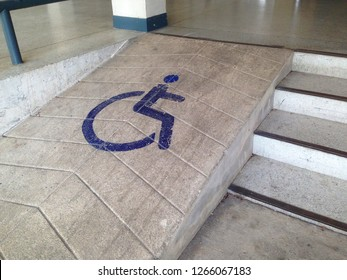Steep slopes for the disabled. Way up for wheelchair.