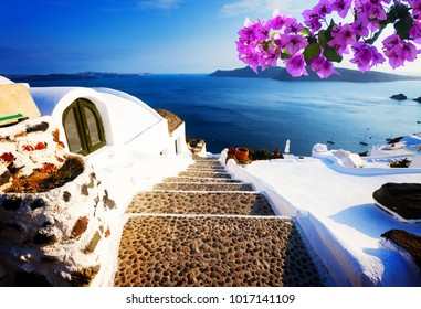 steep stone steps to the deep blue sea, beautiful details of Santorini island, Greece with flowers