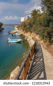 steep trail with wooden railing leading to boats in the fishing village of Sissi in Crete