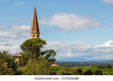 Steeple and clock of church , seen from atop the Medici fortress in Arezzo,Tuscany, Italy