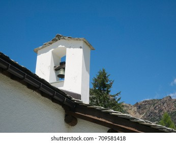 Steeple of small church in a village on the mountains in Valtellina, northern Italy