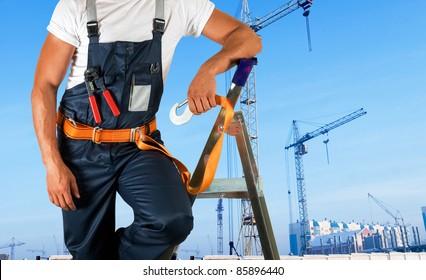 steeplejack on building background