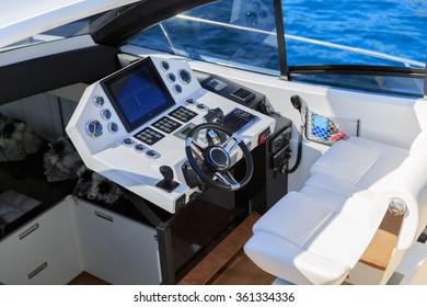 Steering boat of luxury motoryacht at sunset