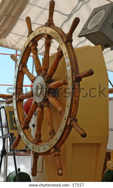 A steering wheel aboard a boat
