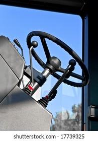 steering wheel in cabin against blue sky