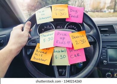Steering wheel covered in colorful notes as a reminder of errands to do