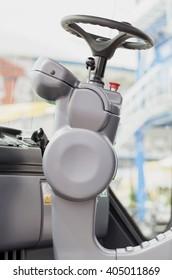 Steering wheel detail - asphalting, construction machine.