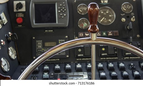 Steering wheel and instrument panel in a motor yacht cockpit