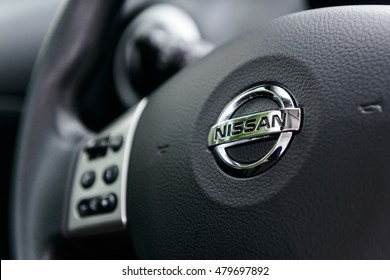 Steering wheel of Nissan Note with logo. NIZHNY NOVGOROD, RUSSIA - SEPTEMBER 07, 2016: Parked car in the center of city open by owner and specially prepared for taking pictures.