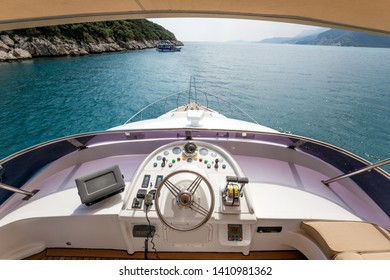 Steering wheel on a luxury yacht cabin