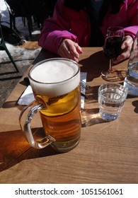 Stein of beer on restaurant table  in an alpine village, Chatel, France