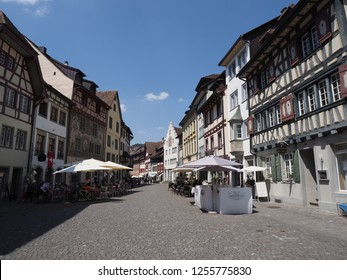 STEIN am RHEIN, SWITZERLAND on AUGUST 2018: Colorful old houses at street on main market square in swiss european town at Schaffhausen canton with clear blue sky in warm sunny summer day.