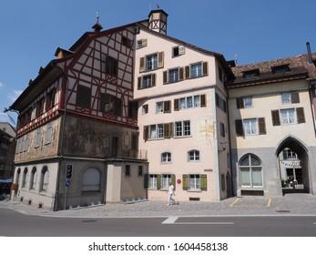STEIN am RHEIN, SWITZERLAND on AUGUST 2018: Medieval buildings at street in center in european town at Schaffhausen canton, clear blue sky in warm sunny summer day. - Shutterstock ID 1604458138