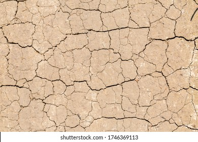 Steinebach, Bavaria / Germany - May 21, 2020: Top down view on dry soil with cracks. Cracked earth / ground. Symbol for climate change, global warming, dryness, drought or wasteland.