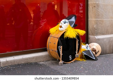Steinenbachgaesslein, Basel, Switzerland - March 11th, 2019. Close-up of a drum and carnival masks