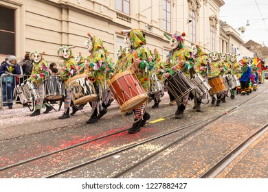 Steinenberg, Basel, Switzerland - February 19th, 2018. A group of carnival participants in colorful costumes playing snare drums