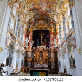 Steingaden, Upper Bavaria / Germany - March 2018: Walls adorned by white and gold artwork and statues on the interior of the Pilgrimage Church of Wies.