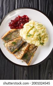 Stekt stromming or fried herring is a hearty Swedish food with boiled potatoes closeup in the plate on the table. Vertical top view from above - Shutterstock ID 2001024545