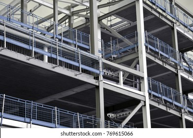 stell framed building under construction with blue railings