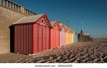 Stella Plage, France - 21 July 2020: Beach cabins with vibrant colors on the French coast. Perspective view.