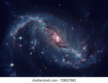 Stellar Nursery in the arms of NGC 1672. NGC 1672 is a barred spiral galaxy located in the constellation Dorado. Retouched image. Elements of this image furnished by NASA.