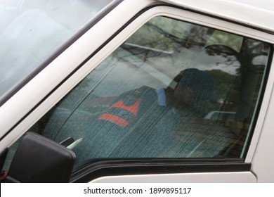 STELLENBO, SOUTH AFRICA - Aug 19, 2009: Police officer's reflection caught in n vehicles window as he inspects the vehicle