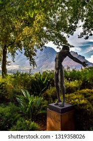 Stellenbosch, South Africa - April 18th 2016: Faith by Anton Smit, a metal sculpture of a man on the gardens of Delaire Graff Estate overlooking the beautiful landscape of the vineyards and mountains