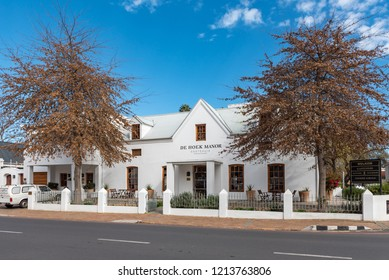STELLENBOSCH, SOUTH AFRICA, AUGUST 15, 2018: The De Hoek Manor Guesthouse in Stellenbosch in the Western Cape Province. A vehicles is visible