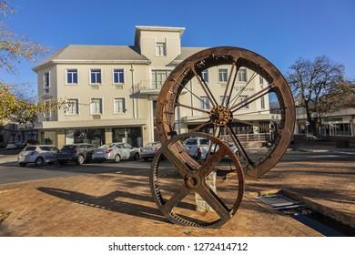 STELLENBOSCH, SOUTH AFRICA - JULY 15, 2018: Stellenbosch: historic overshot waterwheel of Nieuwe Molen (mill). Stellenbosch - town in Western Cape province of South Africa, 50 km east of Cape Town.