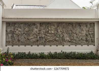 STELLENBOSCH, SOUTH AFRICA - SEPTEMBER 17, 2018: This is the Huguenot Commemorative Relief which illustrates the culture and life of the French persecuted Huguenots who came to the Western Cape.