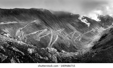 The Stelvio mountain pass is a road that connects the cities of Bormio to Trafoi in  Italy. From the top (elevation 2758m) it is also possible to reach Val Mustair in Switzerland.
