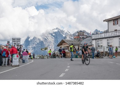 Stelvio Pass, Bolzano, Bormio, Lombardy, Italy - August 22, 2019. Motorcycles and/or bicycles reach the top of the Stelvio Pass in an easterly direction.