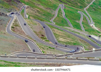 Stelvio Pass / Italy - July 6th, 2019: Long winding road at the last part of the Stelvio Pass seen from the top