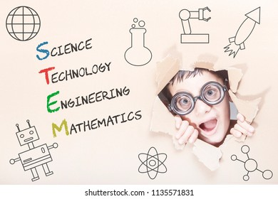 STEM education concept with funny genius kid