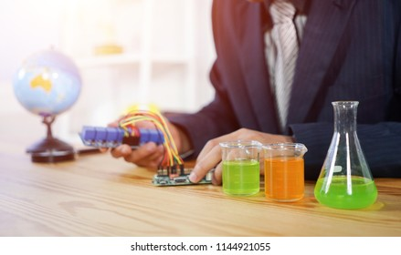 STEM education concept. man coding a meta program it on the computer.electronic board that can be programmed.technology,Mathematics. science. engineering.