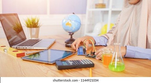 STEM education concept. Woman coding a meta program it on the computer.electronic board that can be programmed.technology,Mathematics. science. engineering.