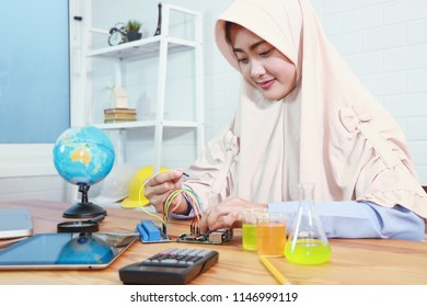 STEM education Laboratory. Beautiful muslim coding a meta program it on the computer.electronic board that can be programmed.technology,Mathematics. science. engineering.