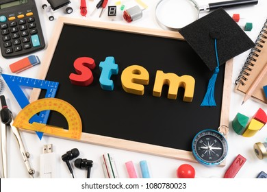 STEM Education. Science Technology Engineering Mathematics. STEM word on blackboard with education equipments for background.