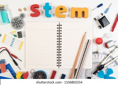 STEM Education. Science Technology Engineering Mathematics. STEM word on book with education equipments for background.