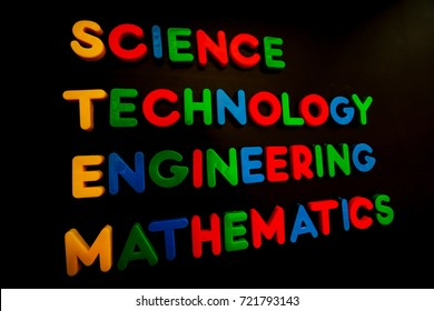 STEM word cloud with colorful plastic letters on black background ,Education STEM concept.